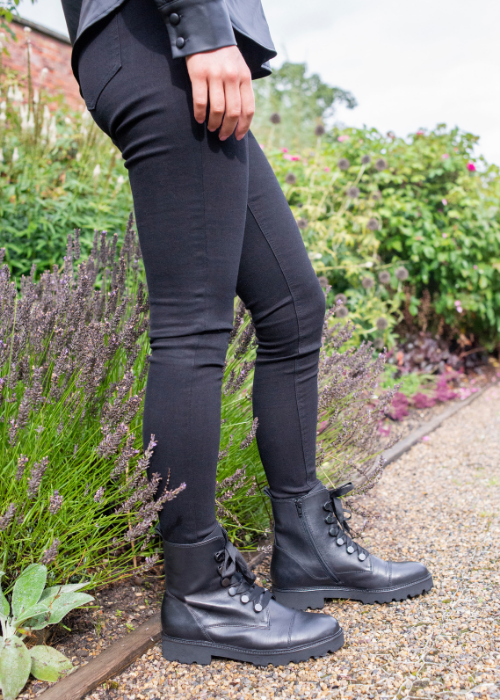 legs wearing biker boots and jeans